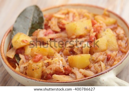 Cabbage and potato stew. Selective focus on a front edge of the dish