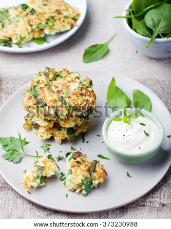 Cabbage and spinach pancakes with yogurt dressing with fresh herbs - stock photo