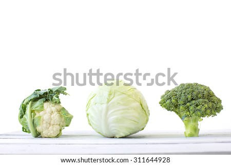Cabbage, broccoli, and cauliflower on a white background. - stock photo