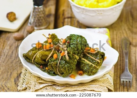 cabbage rolls from a Savoy cabbage and mashed potatoes in a bowl on a wooden table.selective focus - stock photo