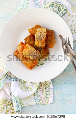 cabbage rolls in a plate on a light background