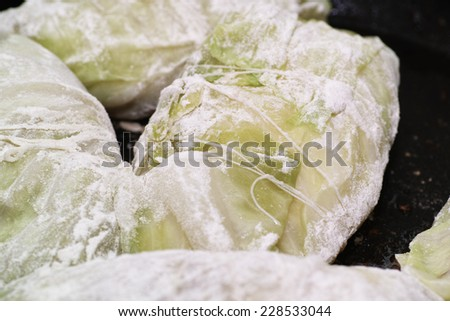 Cabbage rolls. In the Polish kitchen, on the Polish table. Preparing stuffed cabbage, Polish cuisine specialty. - stock photo