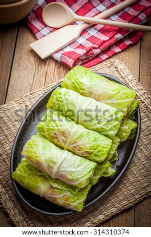Cabbage rolls stuffed with meat and grits prepared for cooking. - stock photo