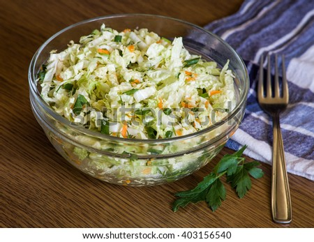Cabbage salad in a glass bowl - stock photo