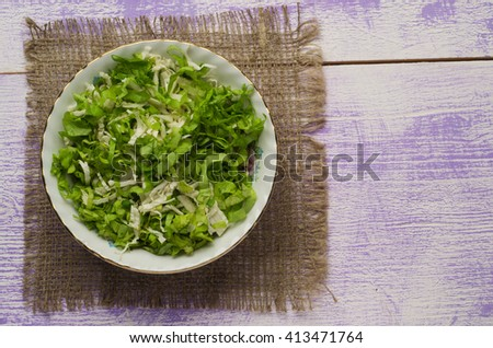 cabbage salad in a plate on a wooden table. Rustic style . Top view. Free space for text. - stock photo