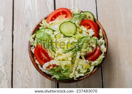 Cabbage salad with cucumbers and tomatoes