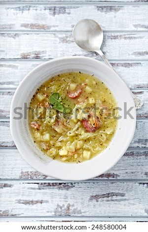 Cabbage soup with sausage (vegetable soup of sauerkraut; Poland)  - stock photo