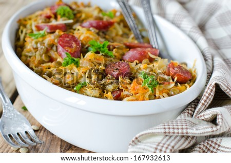 Cabbage stew with lentils and sausages