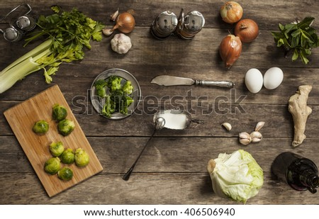 cabbage, tomatoes, garlic and onions on old wooden table.  Food. vintage wooden background.  top view. overhead horizontal view.