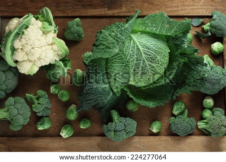 Cabbage variety on  wooden  background - stock photo