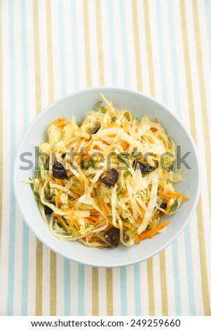 Cabbage with carrot, herbs and prunes