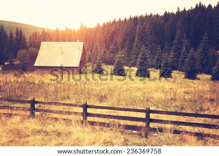 Cabin on the field - stock photo