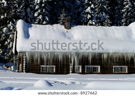 Cabins buried in central Idaho winter