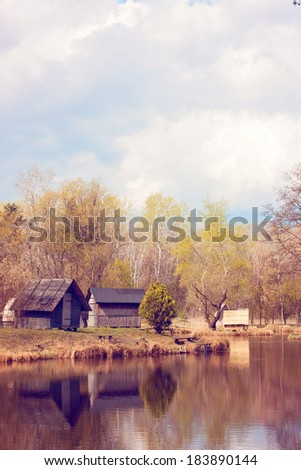 Cabins on the lake shore - stock photo
