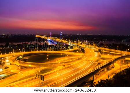 cable bridge and road street at dusk - stock photo
