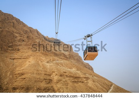Cable car going to famous Masada, Dead Sea Region, Israel - stock photo