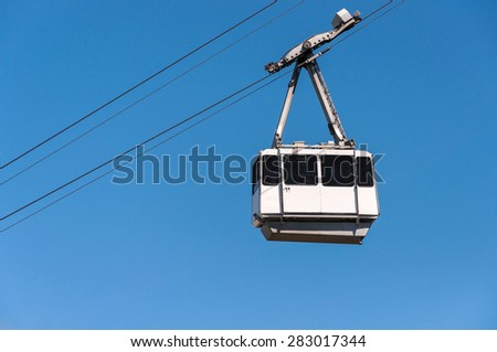 Cable car in the city of Gibraltar close to the top of Gibraltar rock - stock photo