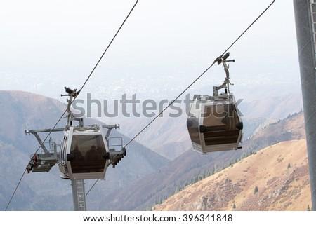 Cable car lift at alpine ski resort shimbulak in Kazakhstan - stock photo