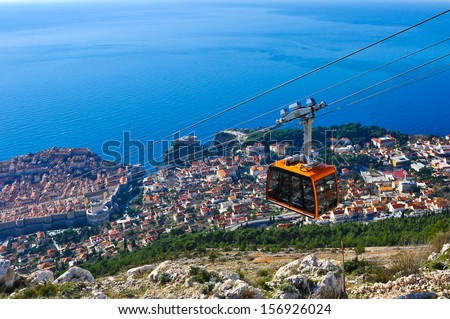 Cable Car moving down to Dubrovnik - stock photo