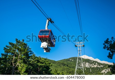 stock-photo-cable-car-on-ropeway-leading