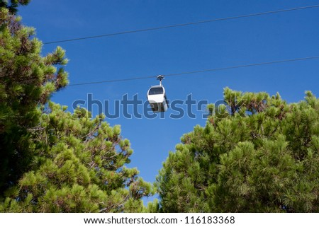 Cable car over the river Tejo (Lisbon, Portugal) - stock photo