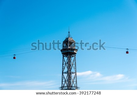 cable cars crossing at a pylon in barcelona harbour - stock photo