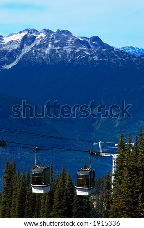 Cable carts / Gondola, pine trees, & peaks of Blackcomb Mountains. More with keyword group14l  - stock photo