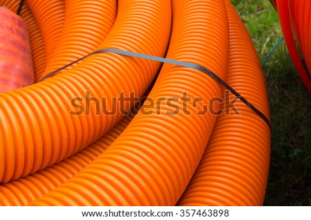 cable hoses for protecting the fiber cables  - stock photo