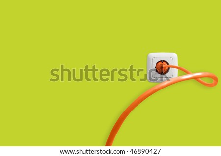 Cable in electric socket - stock photo