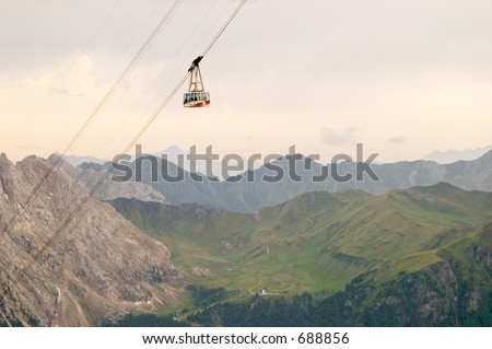Cable railway from pass Pordoi in the Dolomites mountains, Alps, Italy
