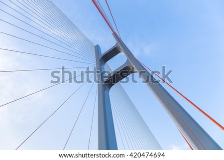 cable stayed bridge closeup against blue sky , upward view - stock photo
