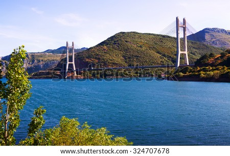 Cable-stayed bridge over reservoir.  Leon - stock photo