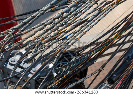 cables and wires on electricity post - stock photo