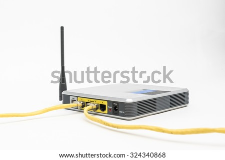 Cables connected to a wireless router isolated - stock photo