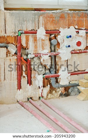 Cables on walls in new house - stock photo