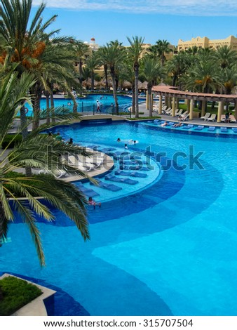 CABO SAN LUCAS, MEXICO - AUGUST 8, 2014: Unidentified people at RIU Santa Fe Hotel at Cabo San Lucas, Mexico. It is a 5 star hotel at Baja California with 902 guest rooms.
