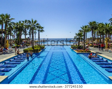 CABO SAN LUCAS, MEXICO - MARCH 16, 2015 : Pool Installation at the Riu Santa Fe All inclusive luxury resort hotel in Cabo San Lucas, part of the International RIU Hotel Chain - stock photo