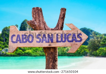Cabo San Lucas wooden sign with beach background - stock photo
