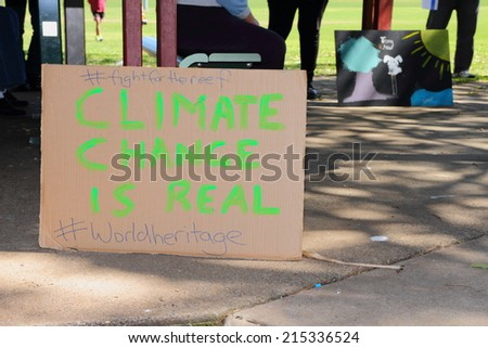 CABOOLTURE, AUSTRALIA - AUGUST 30: Anti LNP government enviroment policies sign shirt at March Australia Rally August 30, 2014 in Caboolture, Australia - stock photo