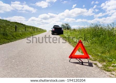 Cabrio with a engine breakdown in a rural scene - stock photo