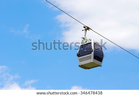 Cabs cable car against the sky - stock photo