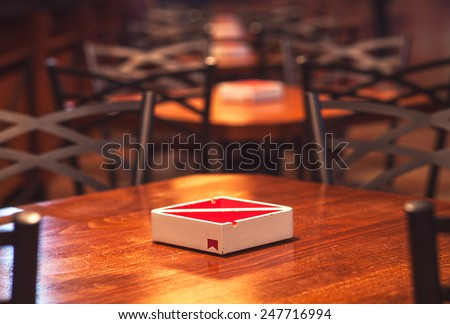 Cacak, Serbia - January 23, 2015: Velvet Cafe and Club interior, wooden chairs, tables and modern Marlboro ashtray design details.   - stock photo