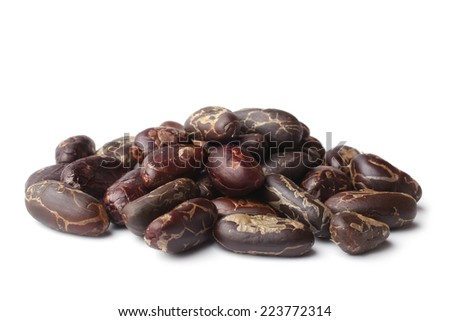 Cacao beans on white background - stock photo