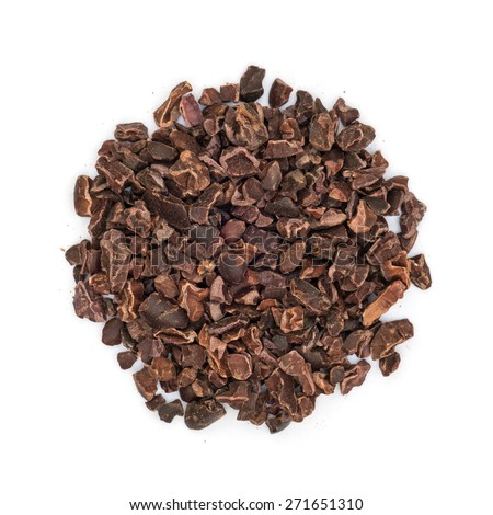Cacao nibs pile isolated on white background, overhead view - stock photo