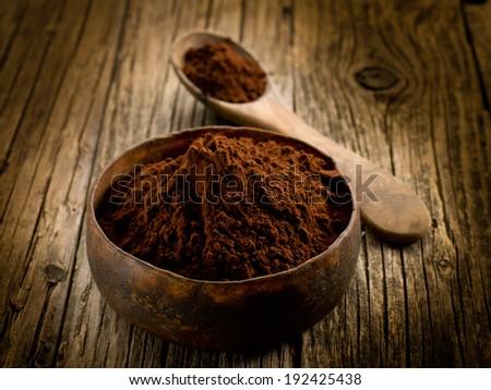 cacao powder on wood bowl - stock photo