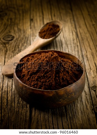 cacao powder on wood bowl - stock photo
