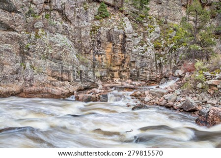 Cache la Poudre River at Big Narrows west of  Fort Collins in northern Colorado - springtime scenery with a snow melt run off - stock photo