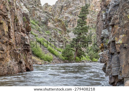 Cache la Poudre River at Little Narrows, springtime scenery with snow melt run off - stock photo