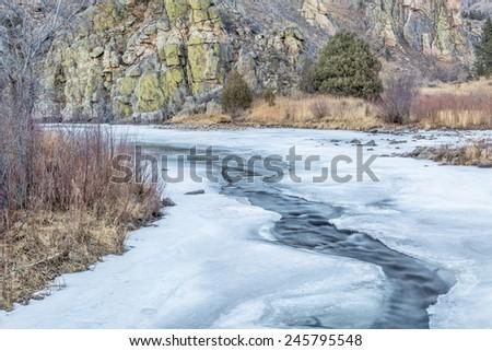 Cache la Poudre River in winter scenery, Gateway Natural Area near Fort Collins, Colorado - stock photo