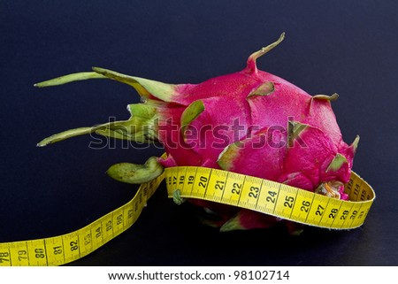 Cactus flower with a yellow tape measure - stock photo